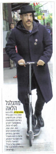 Article from Israel showing Anthony Kiedis riding his scooter on pavement in new York