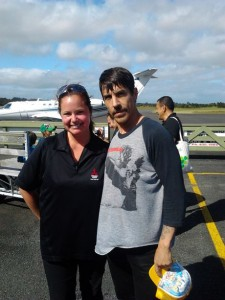 Antony Kiedis poses with a fan at a New Zealnd airport where he'd just flown in on his private jet