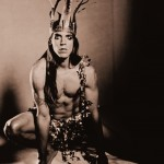Anthony Kiedis Wearing Crown and Loincloth
