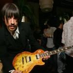 Anthony Kiedis signing autograph on guitar